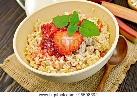 Oatmeal with strawberry-rhubarb sauce on board