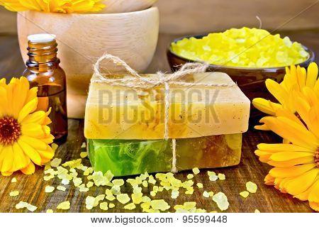 Soap homemade and salt with calendula on board