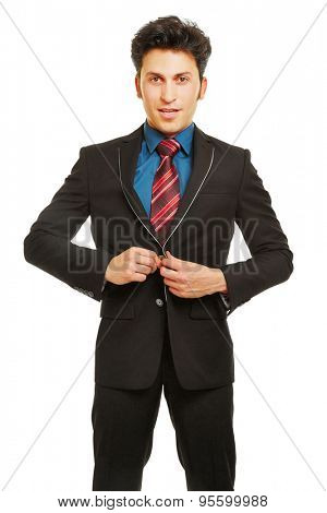 Business man closing button of suit with his hands