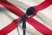 picture of alabama  - Microphone with US states flags on background series  - JPG