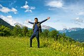 stock photo of snow capped mountains  - Full length of 20s man wearing dark jeans - JPG