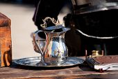 picture of maltese-cross  - A Metal pitcher with Maltese cross on the table - JPG