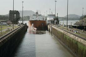 stock photo of passenger ship  - Large cargo ship entering Miraflores Locks at Panama Canal - JPG