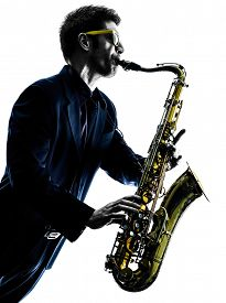 image of saxophone player  - one caucasian man  saxophonist playing saxophone player in studio silhouette isolated on white background - JPG