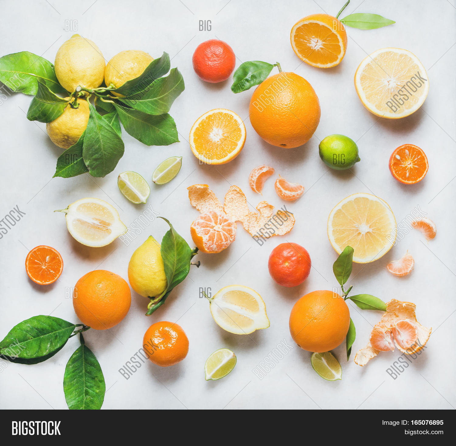 Variety Of Fresh Citrus Fruits For Making Juice Or Smoothie Over Light Grey Marble  Table Background