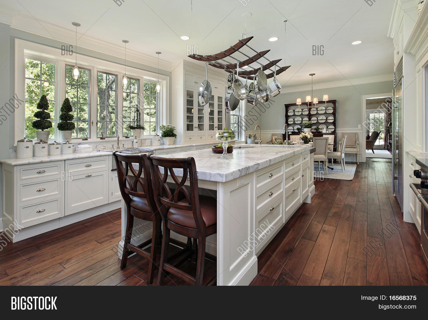 Granite Island Kitchen Kitchen In Luxury Home With White Granite Island Stock Photo