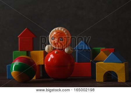 Construction From Wooden Blocks With Ugly Toy