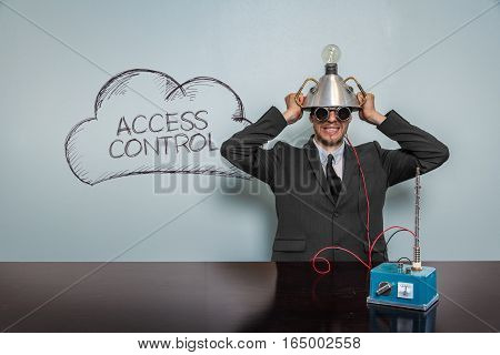 Access Control text with vintage businessman and machine at office