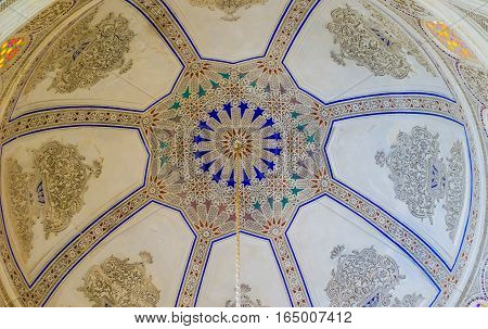 EL KEF TUNISIA - SEPTEMBER 5 2015: The white plaster cupola decorated with the stellar islamic patterns in building of the former mosque serving as Ethnographic Museum on September 5 in El Kef.