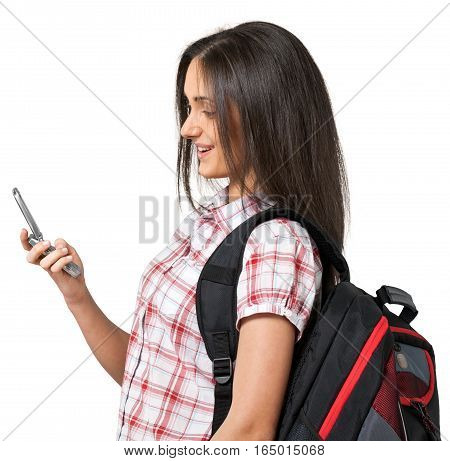 Young woman wearing a backpack while looking at her cell phone