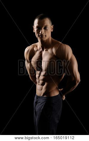 He knows how to push his limits. Vertical shot portrait of a shirtless fitness man showing off his strong muscular body looking to the camera