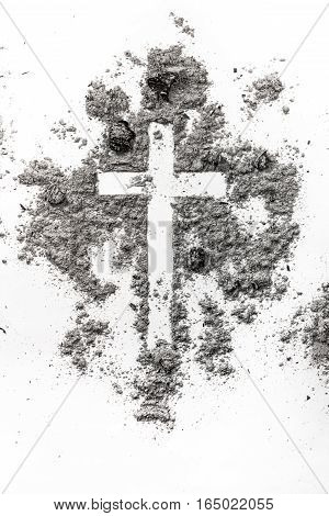 Christian cross made in ash dust as a religion ash wednesday concept background
