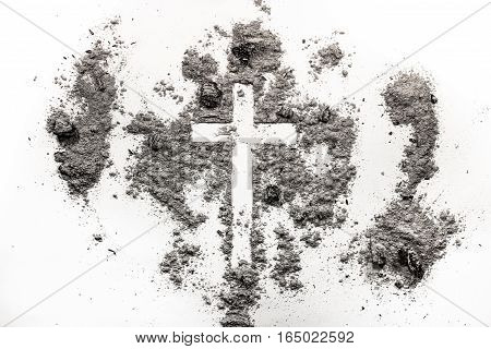 Christian cross crucifix symbol sign made in ash dust. Ash Wednesday concept