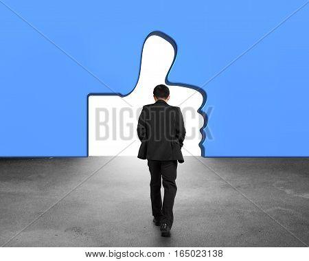 Man Walking Toward Thumb Up Shape Door