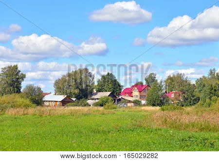 Summer landscape with russian village in the Vologda region by day Russia.