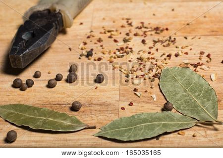 Spices On The Kitchen Board And Pliers