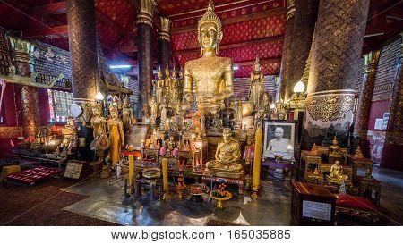 Luang Prabang, Laos - December 3, 2015: Buddha statue at Wat Mai Suwannaphumaham, Luang Prabang, Laos.