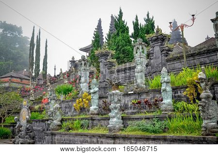 Temple and beauty rock statue at the temple in Bali Indonesia