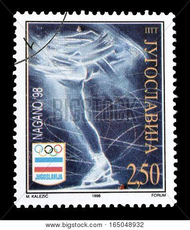 YUGOSLAVIA - CIRCA 1998 : Cancelled postage stamp printed by Yugoslavia, that shows Ice skating.