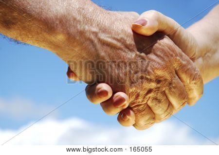 Hand Shake In Golden Shine
