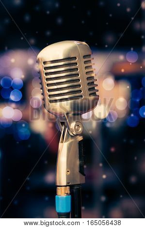 gold microphone on stand close-up at the club