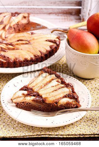 Chocolate and almond tart with pear served