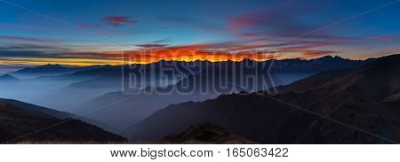 Mountain Silhouette And Stunning Sky At Sunset