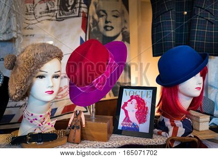 Milan Italy - November 1 2015: women's hats in old fashioned are exposed in a vintage market.