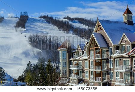 Blue Mountain Village in winter with mountain background