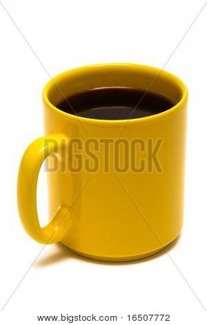 Yellow mug from coffee on a white background