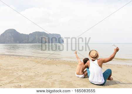 Father and son are happy for picnic with sea view.Zoom in1012