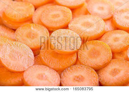 background of carrot slices. Fresh carrot slices