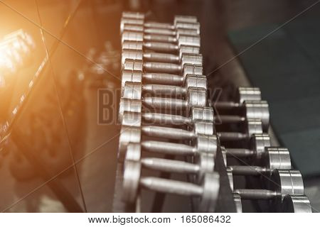 Sports Dumbbells In Modern Sports Club. Weight Training Equipment.
