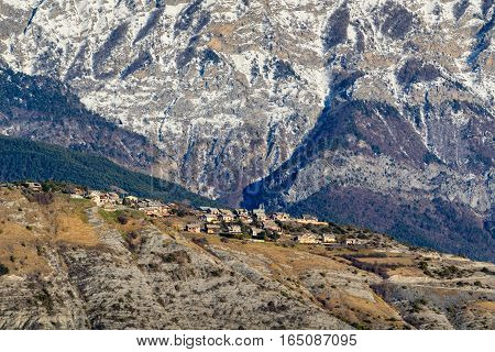 Winter view of Village of Sauze du Lac on plateau with Grand Morgon mountain in the background. Hautes-Alpes French Alps France