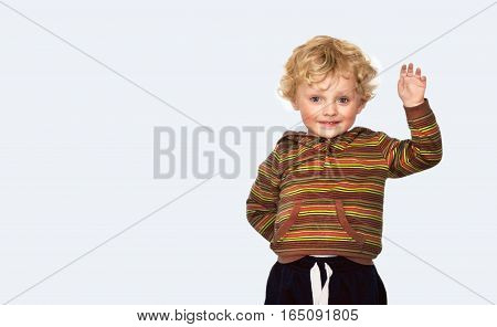 Happy little boy showing something with his hand on a white background