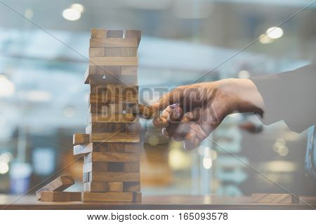Businessman Gambling Placing Wooden Block On A Tower Double Exposure With Chess - Planning, Risk And