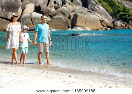 Young beautiful family along tropical beach, Koh Samui island, Thailand, Asia