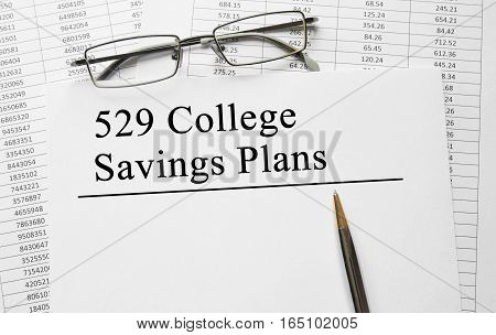 Paper with 529 College Savings Plans on a table