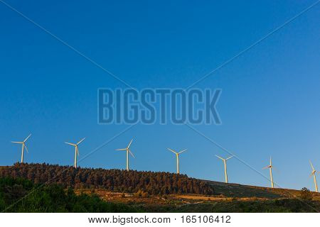Spanish village landscape with windmills in the morning