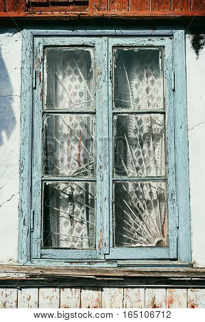 Window of old village house painted blue