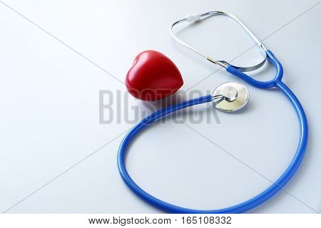 Red heart and a stethoscope Heart Check.Concept healthcare