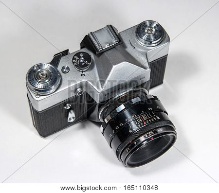 Gatchina, Russia - January 14, 2017: The old Soviet film camera Zenit. Photographed on a bright background. View from above.