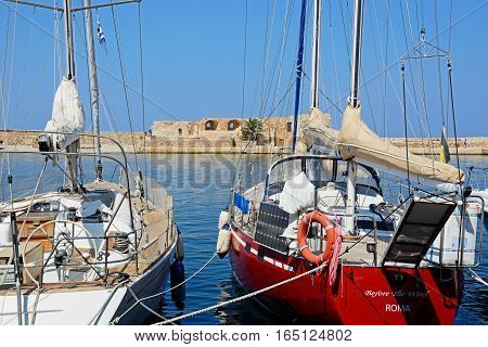 CHANIA, CRETE - SEPTEMBER 16, 2016 - Yachts moored in the marina with the harbour wall to the rear Chania Crete Greece Europe, September 16, 2016.
