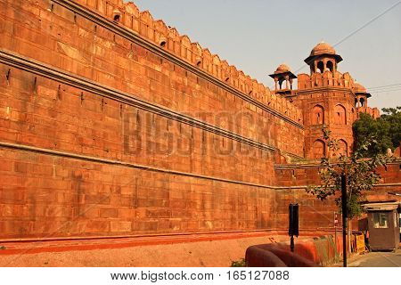 A wall of red fort or Lal Qila in Delhi in the evening sun