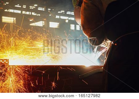 Sparks and smoke from Gouging carbon in industrial