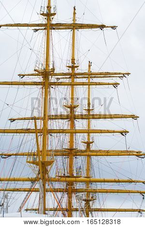 Yellow mast, tall upright post, spar on a ship or boat