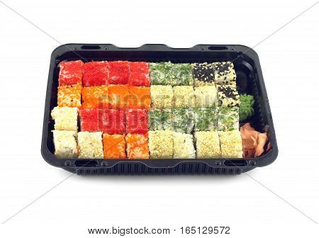 Portions of sushi rolls with fish roe Masago lies inside black plastic container isolated on white closeup