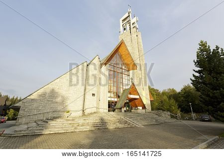 ZAKOPANE POLAND - SEPTEMBER 23 2016: Holy Cross Parish Church was built in 1991. The modern shape of the church with its roof line refers to the architectural style of the region.