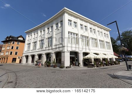 ZAKOPANE POLAND - SEPTEMBER 12 2016: Newly renovated white building at the Independence Square was built in 1938-1942 and is well known because of seat of famous former restaurant Jedrus