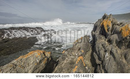 View Of Ocean From Behind The Rocks